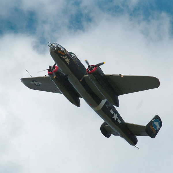 BLAINE FALKENA/Hazleton Standard~Speaker<br /> A WWII-era B-25 banks left during a fly-over before landing at Hazleton Municiapal Airport as part of the Collings Foundation's flying memorial.