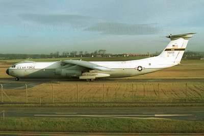 "67-0002. Lockheed C-141B Starlifter. USAF. Prestwick. 1980`s.   ""MAC 70002"" is seen taxying for Runway 13 on a winters morning, after having dropped off it`s cargo at Prestwick.Next stop - Mildenhall. Negative scan."