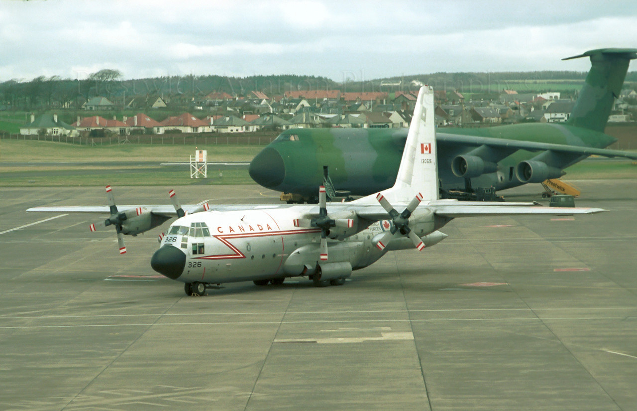 130326. Lockheed CC-130E Hercules. Canadian Armed Forces. Prestwick. 1980`s.<br /> <br /> Negative scan.