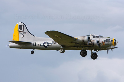 297849. Boeing B-17G Flying Fortress. Private. Prestwick. 020708.  On the morning of June 13, 2011, Liberty Belle made a forced landing in Oswego, Illinois, after taking off from Aurora Municipal Airport in Sugar Grove, Illinois. Shortly after takeoff, the pilot of a T-6 Texan chase plane informed Liberty Belle's pilot that the B-17 inboard left wing was on fire and advised an immediate landing. The bomber landed successfully in a nearby field and the seven people aboard were able to evacuate without injury, but due to the muddy ground the fire engines could not reach it, allowing the fire to spread and destroy the plane.
