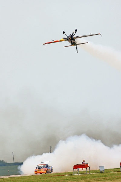 Neal Darnell in the Flash Fire Jet Truck and Patty Wagstaff in the Extra 300S at the 2014 Quad City Air Show