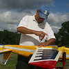 Middlesex County R-C Fliers members fly radio-controlled model airplanes at their field at Vietnam Veterans Park in Billerica. Dan Micalizzi of Billerica assembles his Extra 300 acrobatic plane, a scale model of the Red Bull planes, for a flight. (SUN/Julia Malakie)