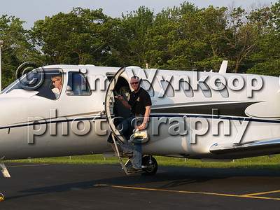 N302CJ: Mark Martin stops for a photo before he boards his Cessna 525A Citation CJ2 following the Pocono 500 on June 8, 2008. His co-pilot, actually PIC on this flight, gets ready for take-off on what would be Mark's last flight on this aircraft. It was to be sold the next day.