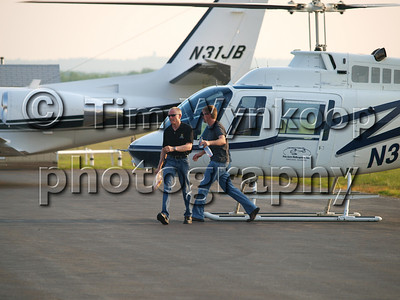 N37CL, Mark Martin and Jeff Burton exit the helicopter. N37CL. Jeff's plane, N31JB is behind the helicopter.