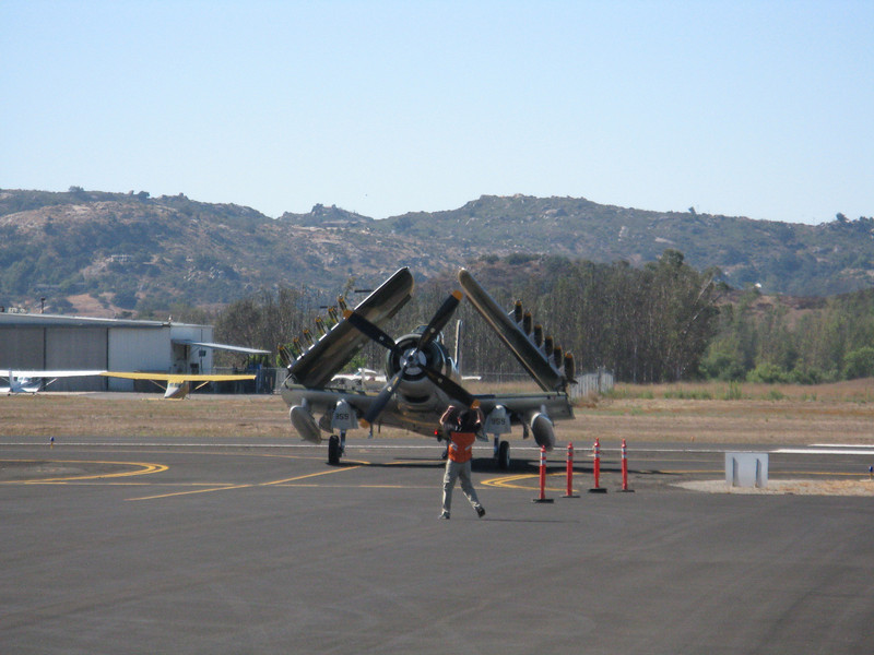 Skyraider coming in with wings folded.