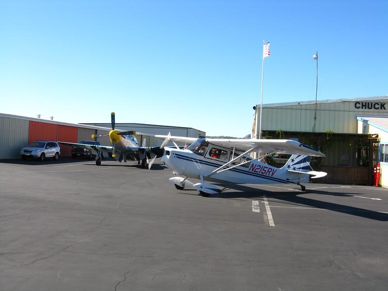 Chuck Hall's P-51 and a Super Decathlon.