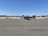 Epsilon taxiing and a Glasair 3 and Lancair IV on the ramp.