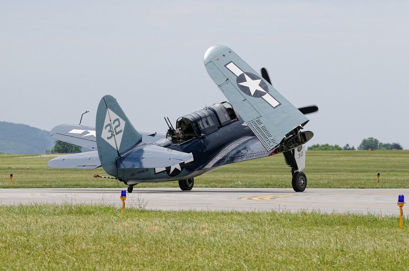 """Curtiss-Wright SB2C-5 """"Helldiver"""" lowering its wings for takeoff"""