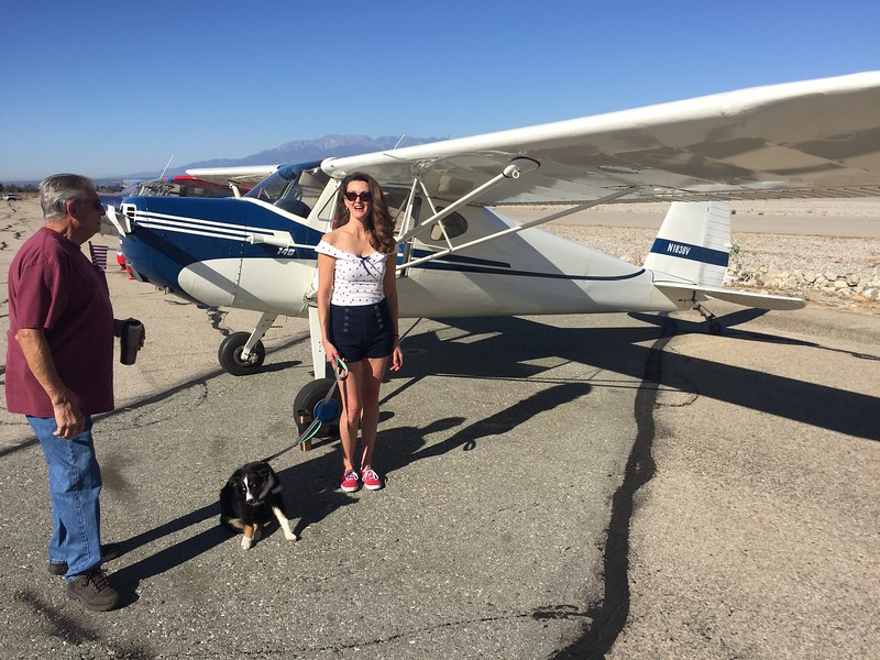 The owner of the Cessna 140 with her new puppy.