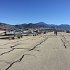 A nice line up of vintage airplanes starting for form up on the flight line.