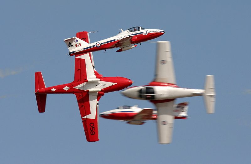 Canadian Snowbirds come together. Two from the left and two from right.