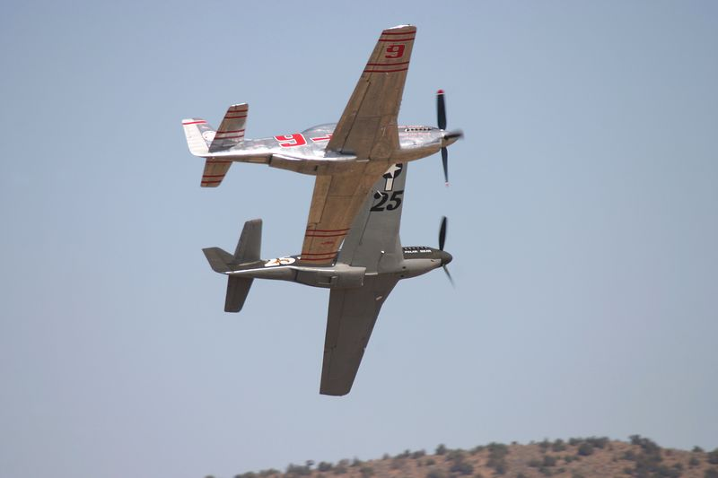 Two P-51's racing.