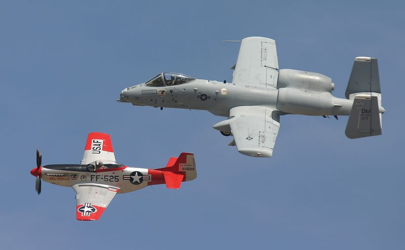 P-51 (foreground) and a Fairchild A-10 in a formation flyby at the Reno Air Races 2005.