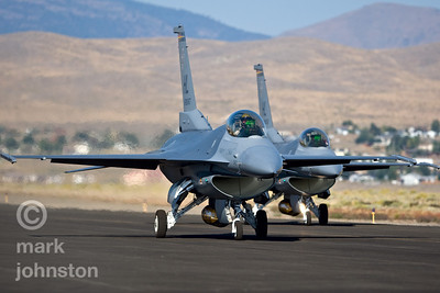 A pair of F-16 Fighting Falcons taxi to the runway after the 2007 Reno Air Races.
