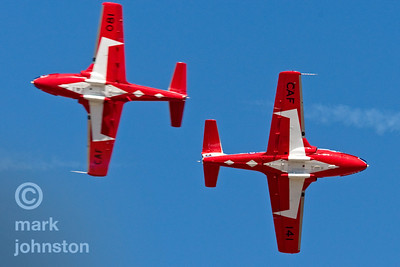The Canadian Forces Snowbirds, have been regular visitors to the Reno Air Races.  Officially known as 431 Squadron, the Snowbirds fly the Canadair CT-114 Tutor, a Canada-built jet used by the Canadian Forces as its basic pilot training aircraft until 2000.  Their tight formations of up to nine aircraft and smooth maneuvers make them favorites with air show fans.  Here, two solo aircraft perform an opposing pass.
