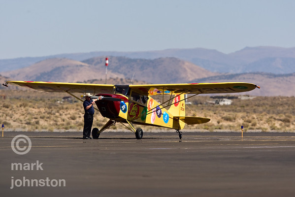 "Kent Pietsch and his 1942 Interstate Cadet in a power-off ""dead stick"" aerobatic routine that starts from an altitude of 6,000 feet and ends with Kent landing at show center, during the 2007 National Championship Air Races and Air Show in Reno, Nevada, USA."