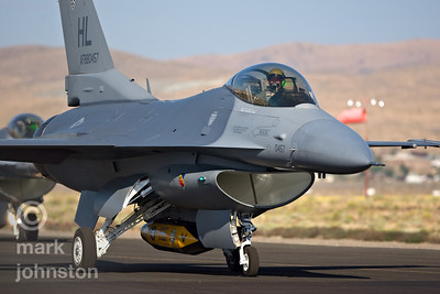 F-16 Fighting Falcons taxi to the runway after the 2007 Reno Air Races.