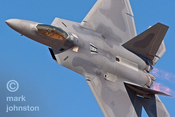 "The Lockheed Martin/Boeing F-22 ""Raptor"" during a flight demonstration at the 2007 Reno Air Races.  The Raptor, which entered service with the US Air Force in December 2005, costs about USD $122 M. This aircraft is from the 192nd Fighter Wing based at Langley Air Force Base, Virginia."
