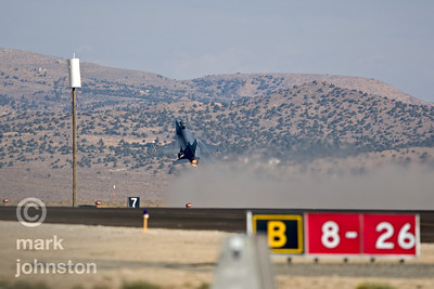 An F-16 Fighting Falcon rotates off the runway, departing the 2007 National Championship Air Races at Reno Stead Field.