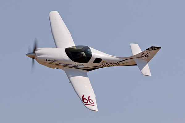 "Ernie Sutter and ""Jus Pass'n Thru"", Race 66, a Lancair Legacy, during a qualifying session at the 2007 National Championship Air Races.  Sutter qualified in 16th position with a speed of 279.850 mph, and went on to finish fifth in the Sport Gold race at a speed of 287.312 mph."