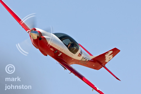 "Bob Jeffrey in ""Lady in Red"", Race 142, a Lancair Legacy, during qualifying at the 2007 National Championship Air Races.  Jeffery and ""Lady in Red"" qualified in 21st position in the Sport Class with a speed of 265.875 mph, and went on to finish fifth in the Sport Silver race at a speed of 275.278 mph."