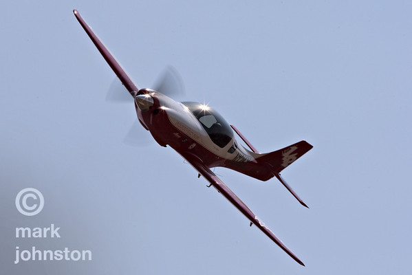 """Bob Jeffrey in """"Lady in Red"""", Race 142, a Lancair Legacy, during qualifying at the 2007 National Championship Air Races.  Jeffery and """"Lady in Red"""" qualified in 21st position in the Sport Class with a speed of 265.875 mph, and went on to finish fifth in the Sport Silver race at a speed of 275.278 mph."""