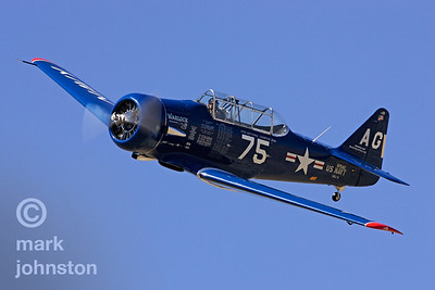 "Al Goss' ""Warlock"", a long-time contender in the T-6 class and the overall class champ in 2004, is an SNJ-6 model, a beautiful example of the Naval variant of the North American T-6 trainer."
