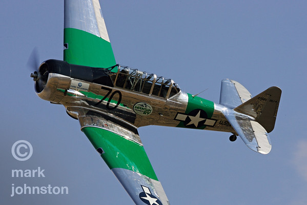 """Mirage"", Jim Thomas' SNJ-4, is part of an exciting class at Reno that features match racing between stock AT-6, SNJ [US Navy], and Harvard [Canadian] versions of the North American WWII-era trainer."