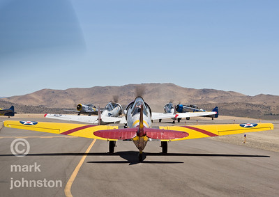 The Reno Air Racing Association sponsors the Pylon Racing Seminar as a unique and productive opportunity for race pilots to prepare, practice, and become certified to race in the National Championship Air Races.  The Pylon Racing Seminar is held at Nevada's Reno Stead Field during the month of June.  Here, T-6 aircraft taxi out for a practice race.