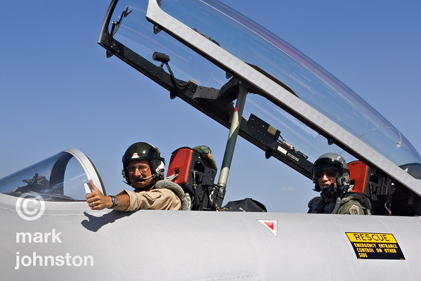 """Unlimited Class pace plane pilot and veteran racer Steve Hinton gives a """"thumbs up"""" from the cockpit of the T-33 pace jet as he taxis out to guide another race at the 2007 National Championship Air Races in Reno, Nevada, USA."""