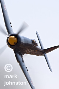 "CJ Stephens pilots Unlimited Class Race 114, ""Argonaut"", a Hawker Sea Fury, around the race course during qualifying for the 2007 National Championship Air Races in Reno, Nevada, USA."