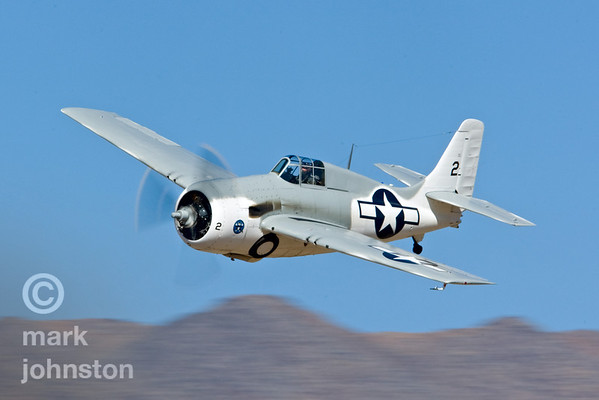 """Tom Camp's Grumman Wildcat, """"Air Biscuit"""", Race 2, while one of the slowest of the Unlimited Class racers, is still a treat to see on the race course and on the ramp at the Reno Air Races. Here, Camp flies """"Air Biscuit""""  to a ninth-place finish in the Unlimited Bronze Race on 16 Sept 2007, at a speed of 280.516 mph"""