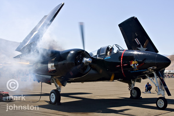 """Mike Brown starts up one of the engines in F7F Tigercat """"Big Bossman"""", Unlimited Class Race 1, at the 2007 National Championship Air Races."""