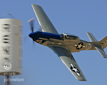 """Lady Jo"", a North American P-51D Mustang, rounds pylon 7 during the National Championship Air Races and Air Show in Reno, NV."