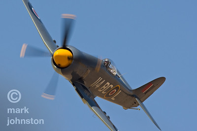 "CJ Stephens and Unlimited Class Race 114, ""Argonaut"", a Hawker Sea Fury, flying the course during practice at the 2007 Pylon Racing Seminar in Reno, Nevada, USA."