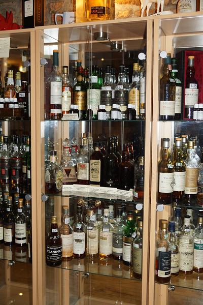 The Dornoch Castle Hotel displays ( and has an extensive cellar as well)  a wonderfully rich selection of whiskys to the arriving pilot/golfer/traveller just waiting to take the edge off that cold feeling