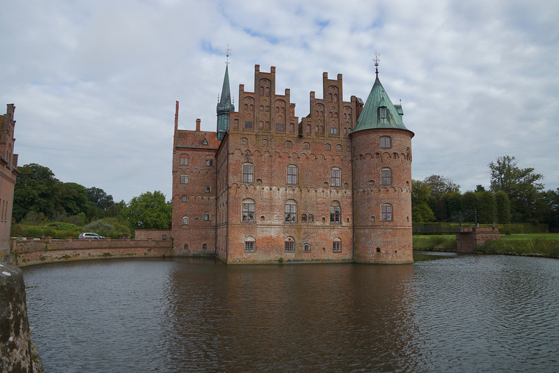 Egeskov Slot, a fantastic grand country castle house built on hundreds of oak tree trunks driven down into the ground as piles. Nowhere in Denmark is far above the water table...