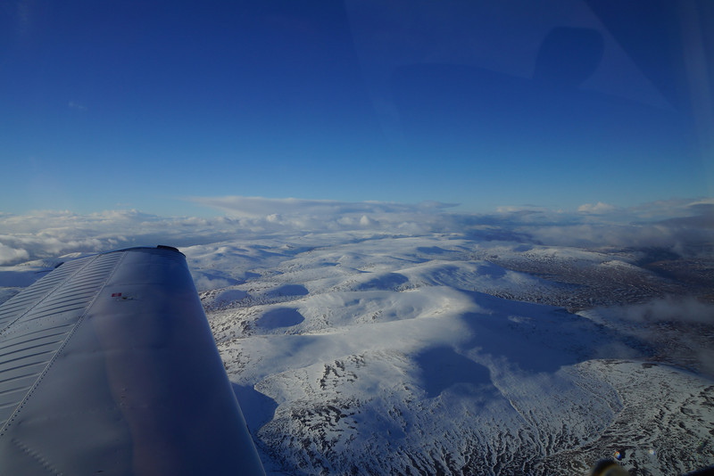 A mild and bright winter's day sees us heading north in G-OOJP to Dornoch to the grass field amid the golf courses with the threat of snow showers ahead