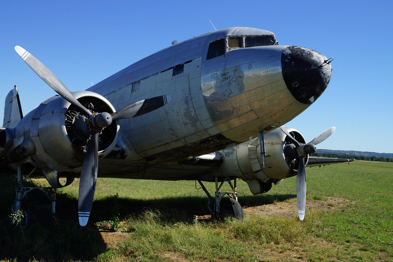 A sad old DC3 chewing the cud at Fredericksburg, Texas while watching the COGs play nearby