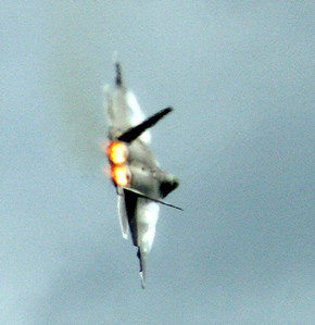F-22 in tight turn with air condensation showing on wing edges