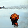 A World War II Japanese Zero flies near a fiery blast simulating explosions during Tora Tora Tora re-enacment of the bombing of Pearl Harbor at Saturday's Rocky Mountain Airshow at Rocky Mountain Metropolitan Airport.<br /> August 27, 2011<br /> staff photo/ David R. Jennings