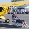 John Barrett stays in the shade of his Piper airplane during Saturday's Rocky Mountain Airshow at Rocky Mountain Metropolitan Airport.<br /> August 27, 2011<br /> staff photo/ David R. Jennings