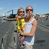 Julie Powll and her daughter Ava, 2 1/2, from Highlands Ranch, watch airplane performances during Saturday's Rocky Mountain Airshow at Rocky Mountain Metropolitan Airport.<br /> August 27, 2011<br /> staff photo/ David R. Jennings