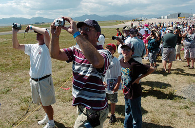 All eyes and cameras of fans watch the U.S. Airforce B-2 bomber fly over Rocky Mountain Metropolitan Airport during Saturday's Rocky Mountain Airshow. August 27, 2011 staff photo/ David R. Jennings
