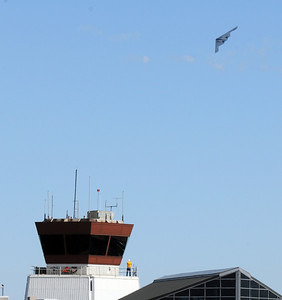 The U.S. Airforce B-2 bomber turns as it flies past the old control tower of Rocky Mountain Metropolitan Airport during Saturday's Rocky Mountain Airshow. August 27, 2011 staff photo/ David R. Jennings