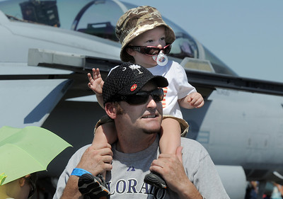 Richard Dillon and his son Aiden, 17 months-old, of Littleton, watch an aircraft perfomance during Saturday's Rocky Mountain Airshow at Rocky Mountain Metropolitan Airport. August 27, 2011 staff photo/ David R. Jennings