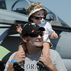 Richard Dillon and his son Aiden, 17 months-old, of Littleton, watch an aircraft perfomance during Saturday's Rocky Mountain Airshow at Rocky Mountain Metropolitan Airport.<br /> August 27, 2011<br /> staff photo/ David R. Jennings