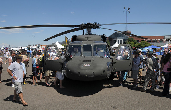 Lines from both directions of people formed to look at a Colorado National Guard helicopter during Saturday's Rocky Mountain Airshow at Rocky Mountain Metropolitan Airport.<br /> August 27, 2011<br /> staff photo/ David R. Jennings