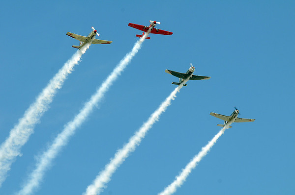 World War II airplanes fly in formation during Saturday's Rocky Mountain Airshow at Rocky Mountain Metropolitan Airport.<br /> August 27, 2011<br /> staff photo/ David R. Jennings