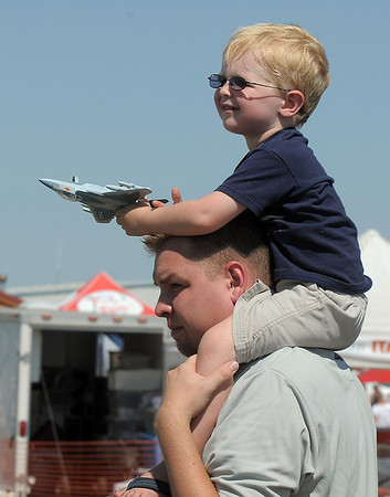 Blake Lanterman, 3, holds on to his toy jet while riding on the shoulders of his father, Brian, during Saturday's Rocky Mountain Airshow at Rocky Mountain Metropolitan Airport.<br /> August 27, 2011<br /> staff photo/ David R. Jennings